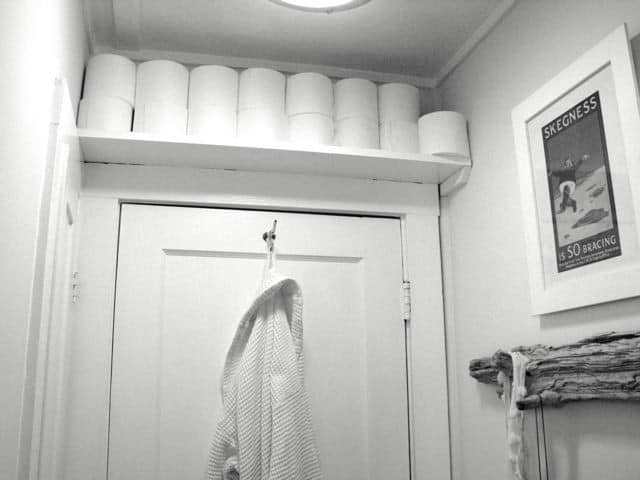 Frame the bathroom's doorway with a shelf to hold toiletry items