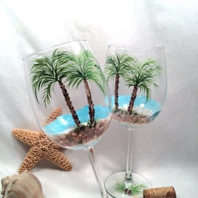 Beach theme palm tree pair of hand painted wine glasses