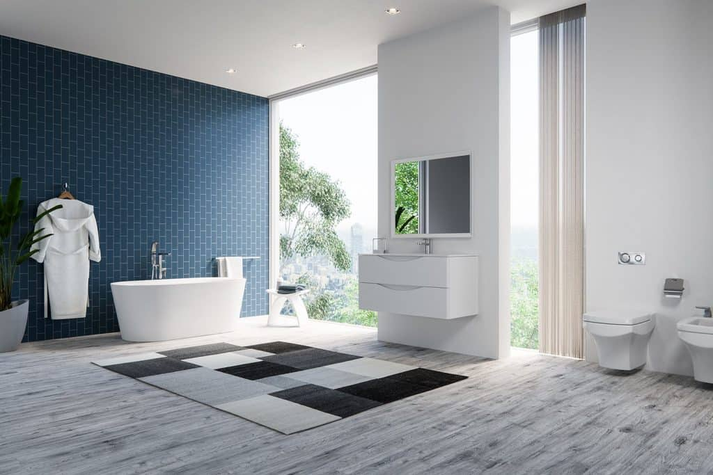 Can Laminate Flooring Be Installed in A Bathroom? [ANSWERED] on interior doors for bathrooms, baseboard for bathrooms, vct flooring for bathrooms, tile flooring ideas for bathrooms, hickory cabinets for bathrooms, ceramic tile for bathrooms, painted walls for bathrooms, paper flooring for bathrooms, kitchen cabinets for bathrooms, cork for bathrooms, silestone countertops for bathrooms, wall texture for bathrooms, duraceramic for bathrooms, wood for bathrooms, linoleum flooring for bathrooms, bamboo flooring for bathrooms, neutral decor for bathrooms, sub flooring for bathrooms, basement flooring for bathrooms, commercial tile for bathrooms,