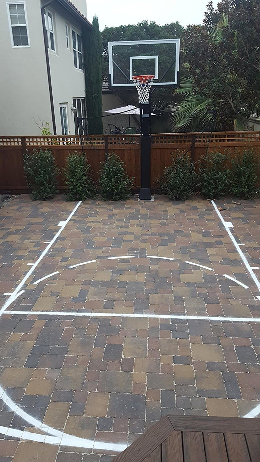 Backyard basketball court black and grey backyard for Home basketball court size