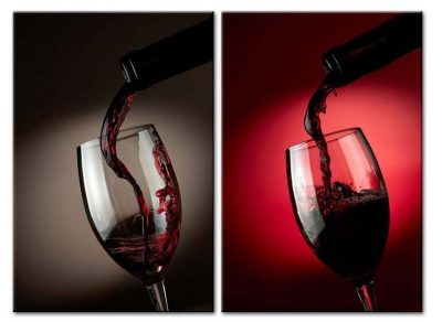 Wine Splash From Bottle Into Wine Glass On Black And Red