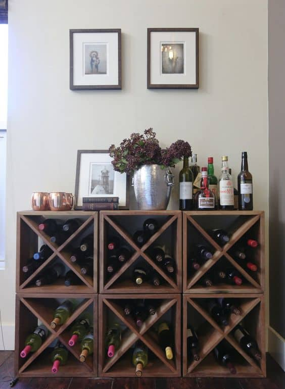 X-Shaped wine rack houses 4 sections of wine bottles