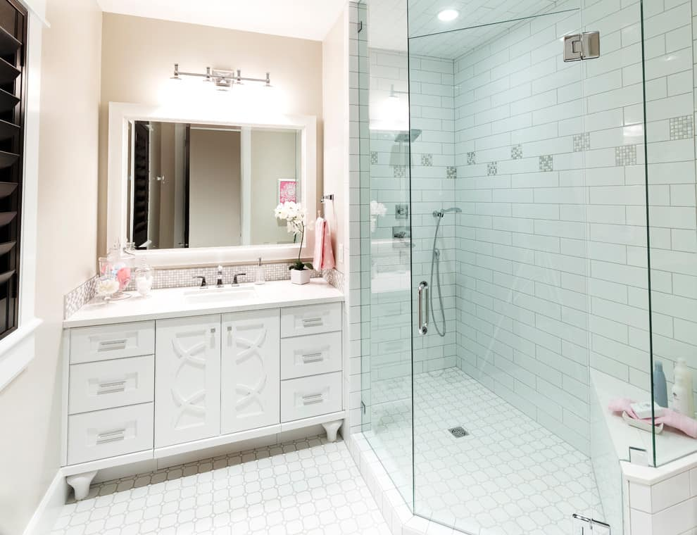 Alcove shower, white tile floor and walls