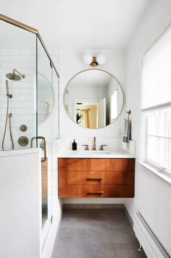 Small corner shower, white tiles, grey floor