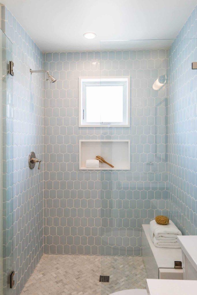 Small beach style bathroom, grey tile floor, blue tile walls