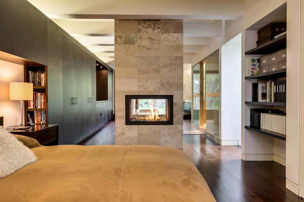 light colors and continuous tiling from to ceiling brings the eye directly to the fire and not focused on the surround