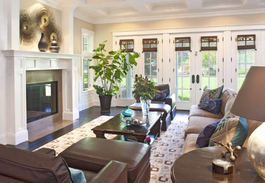 Brown pull-down shades are bold against the white French doors