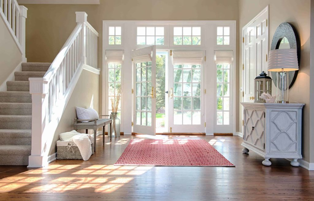 subtle cream shades on the French doors in this entryway