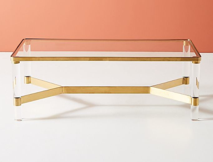 Brass plated steel base, acrylic legs, tempered glass top with rounded corners