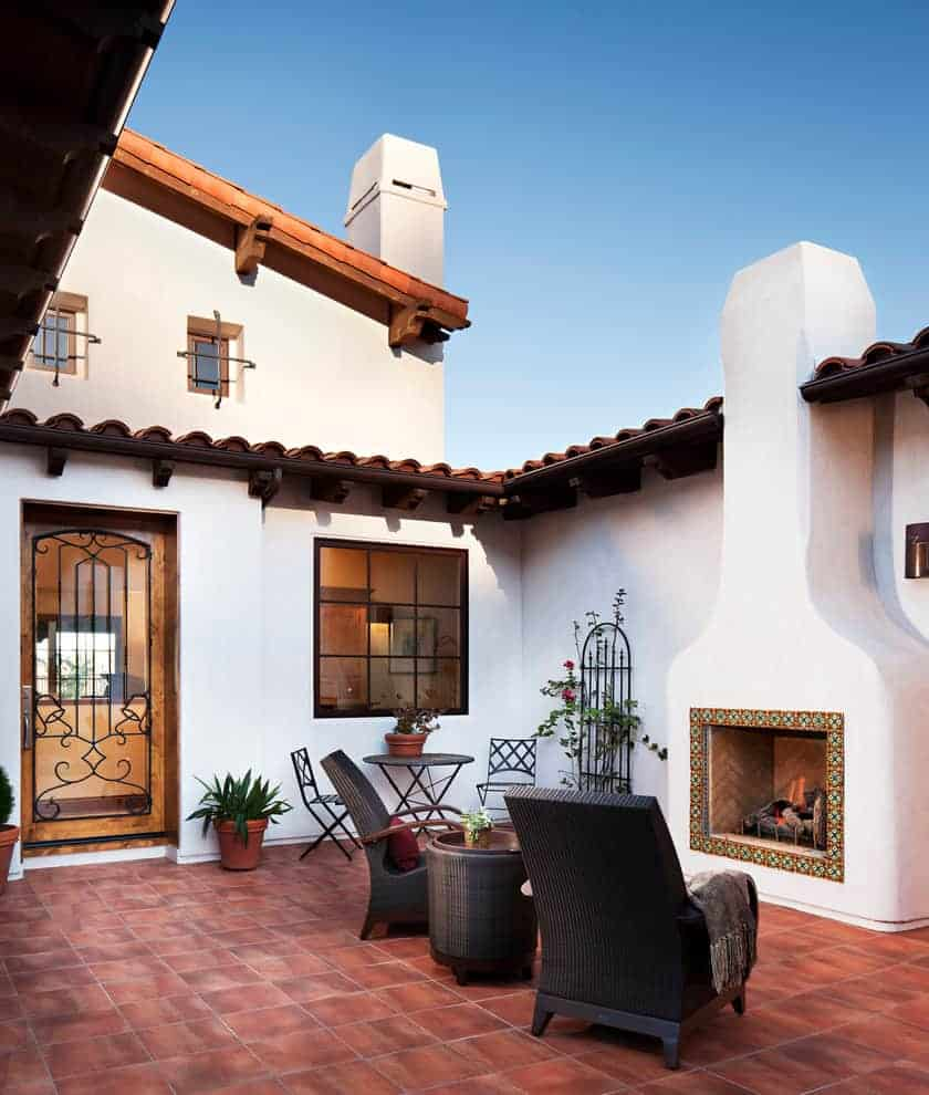 tiled fireplace ideas - colorful tiles surrounding this outdoor fireplace