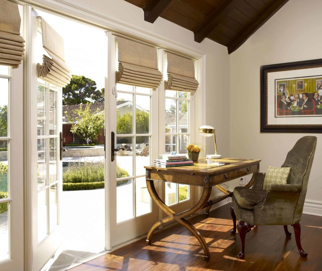 Linen sand-colored Roman shades on the French doors