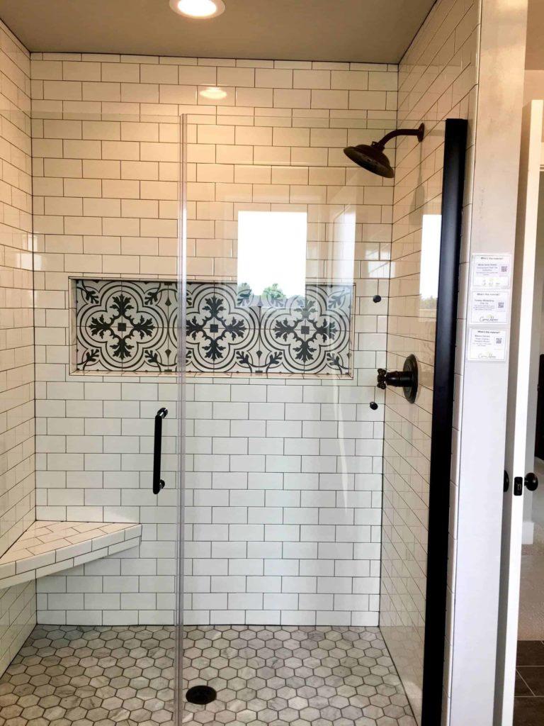 Small white tile alcove bathroom, grey tile floor