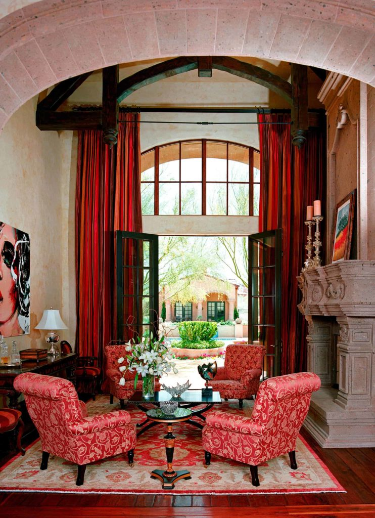deep red drapery covering the French doors