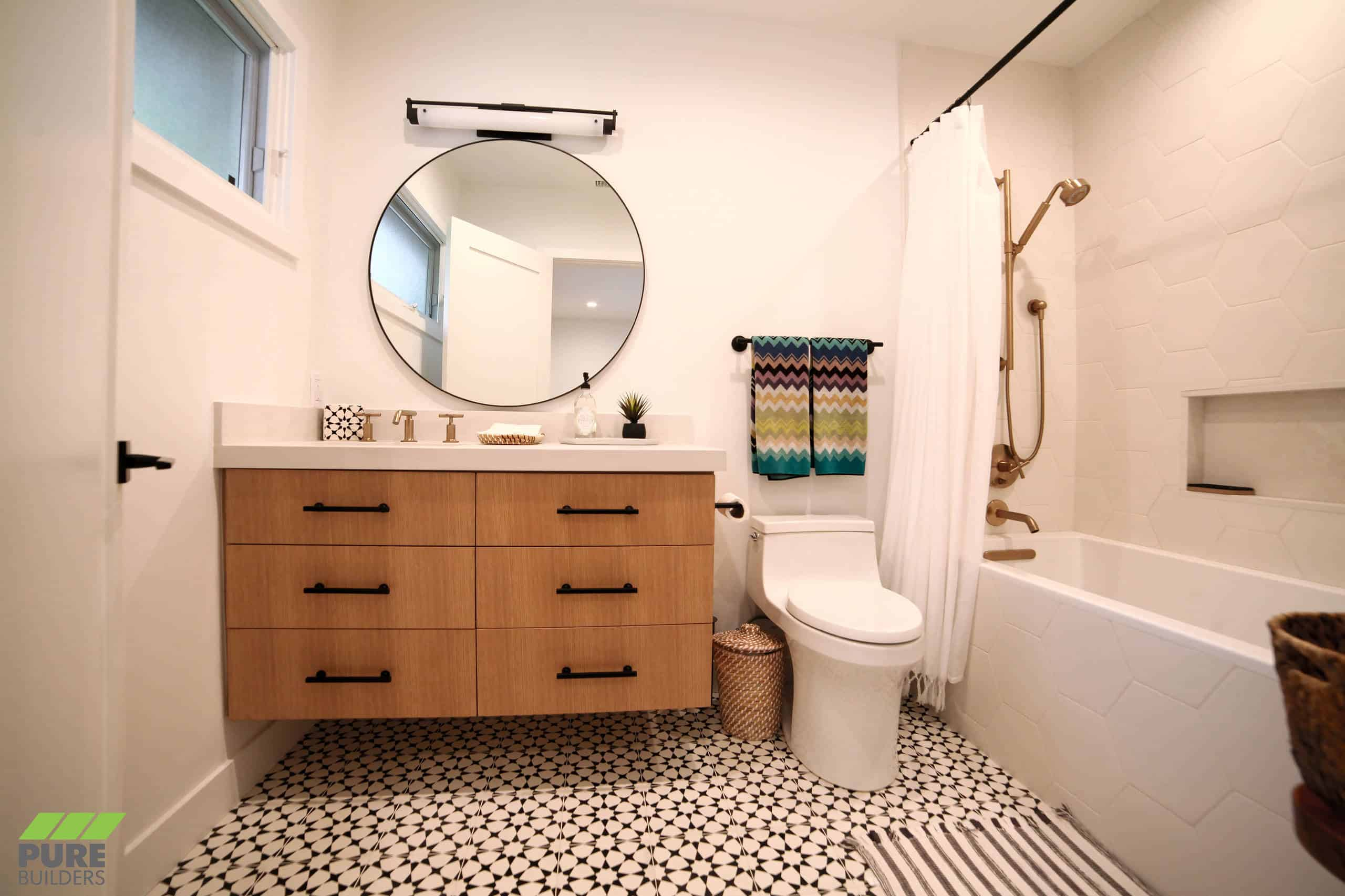 White honey comb tile walls, black and white pattern floor, wooden cabinets