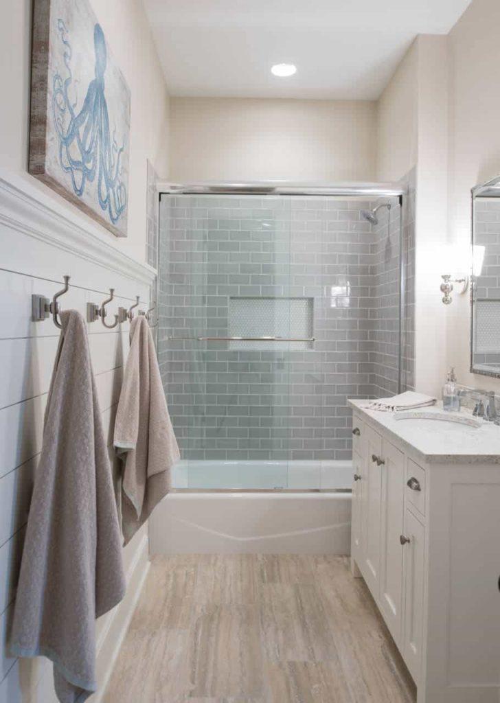 Beach style bathroom, grey tile walls, brown floor