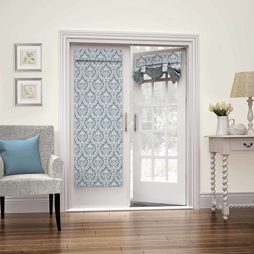 Romantic white and blue tie-up window coverings on traditional white French doors
