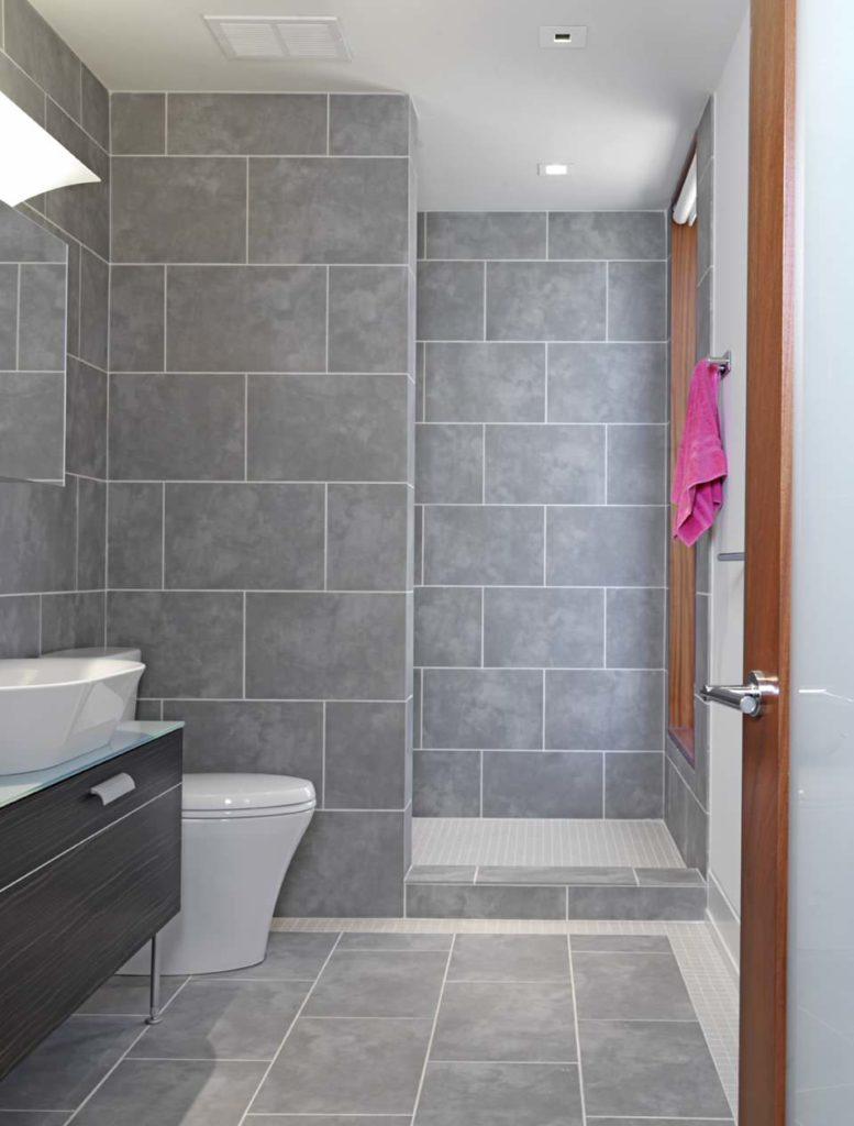 Small bathroom, large grey tile walls and floor