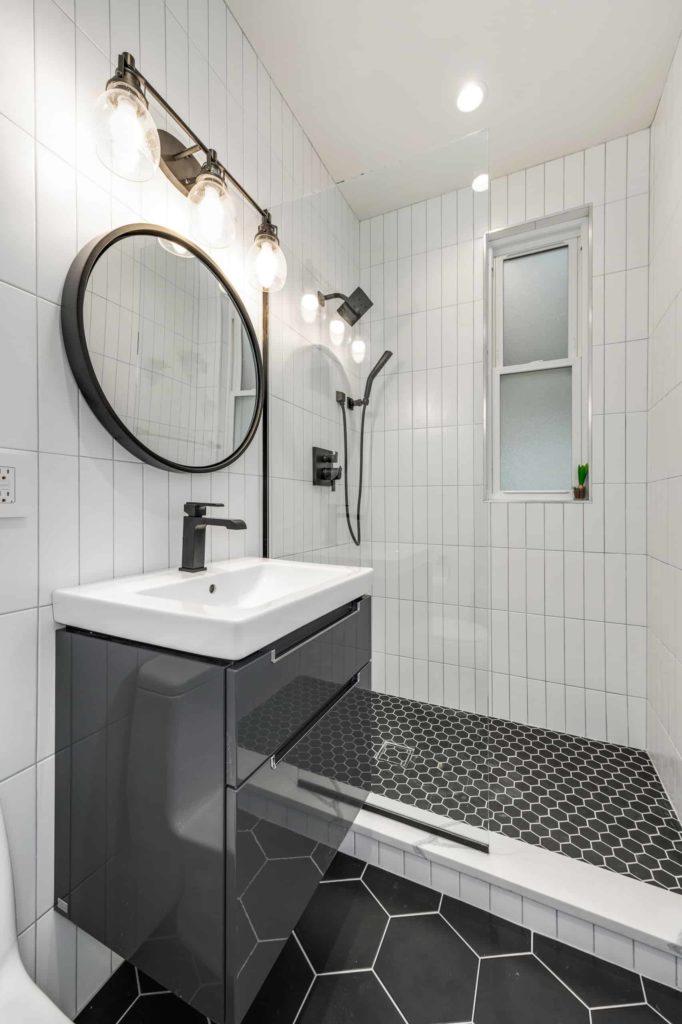 Contemporary bathroom, white tile walls, black hex tile floor