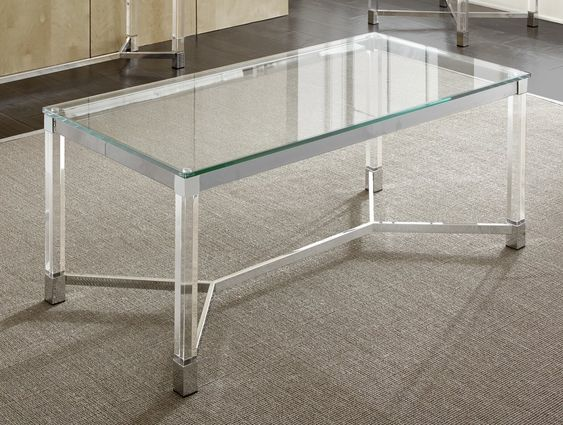 Tempered glass rectengular top, acrylic legs, stainless steel base