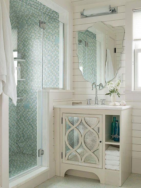 Walk-in shower, white walls, green mosaic tile shower