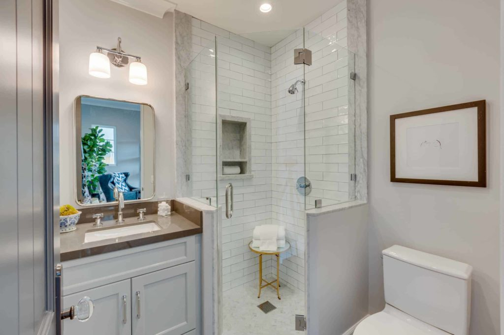Alcove shower, white walls and cabinets, white tile shower