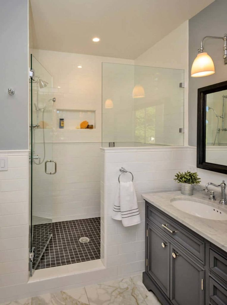 Alcove shower, white walls, black tile shower floor, black cabinets