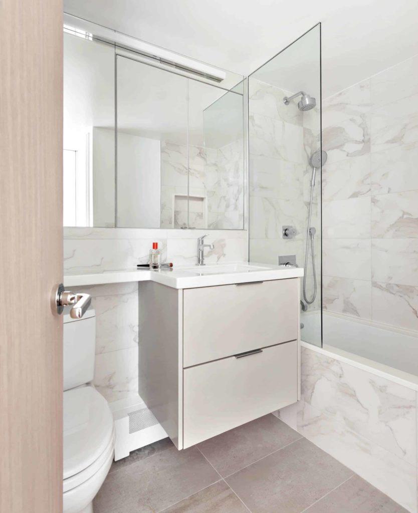 Grey tile floor bathroom, white marble tile walls