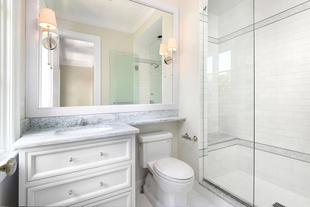Transitional shower, white tile walls and floor