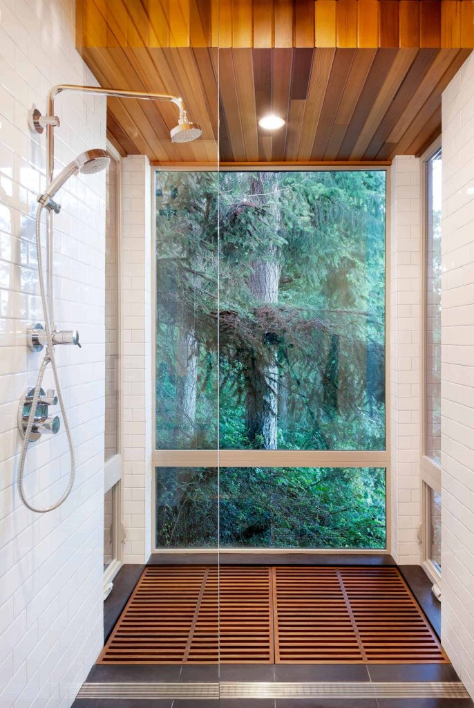 white tile multicolored floor corner shower design in New York