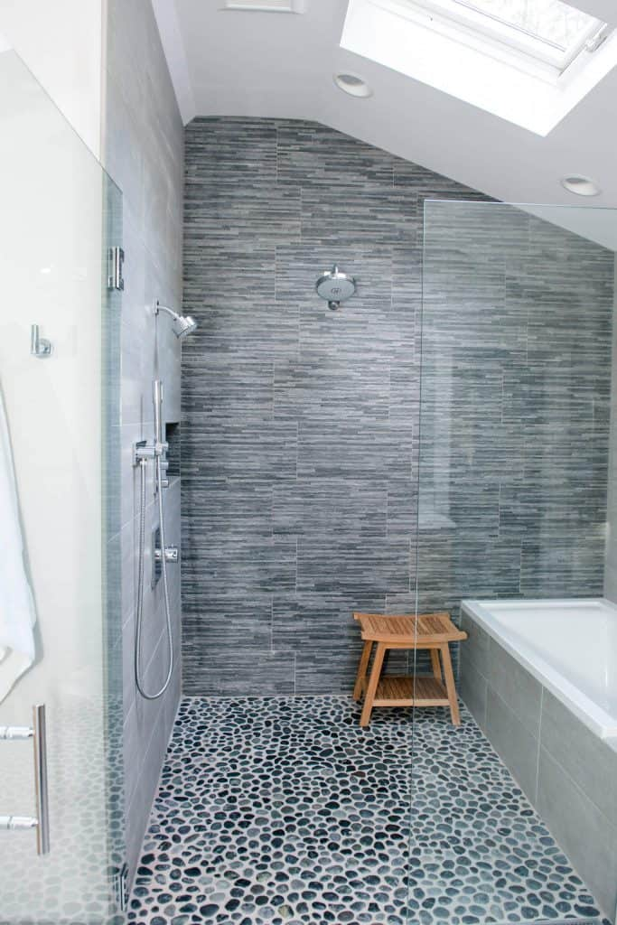 Thin Grey Stripes with Pebbles shower tile idea