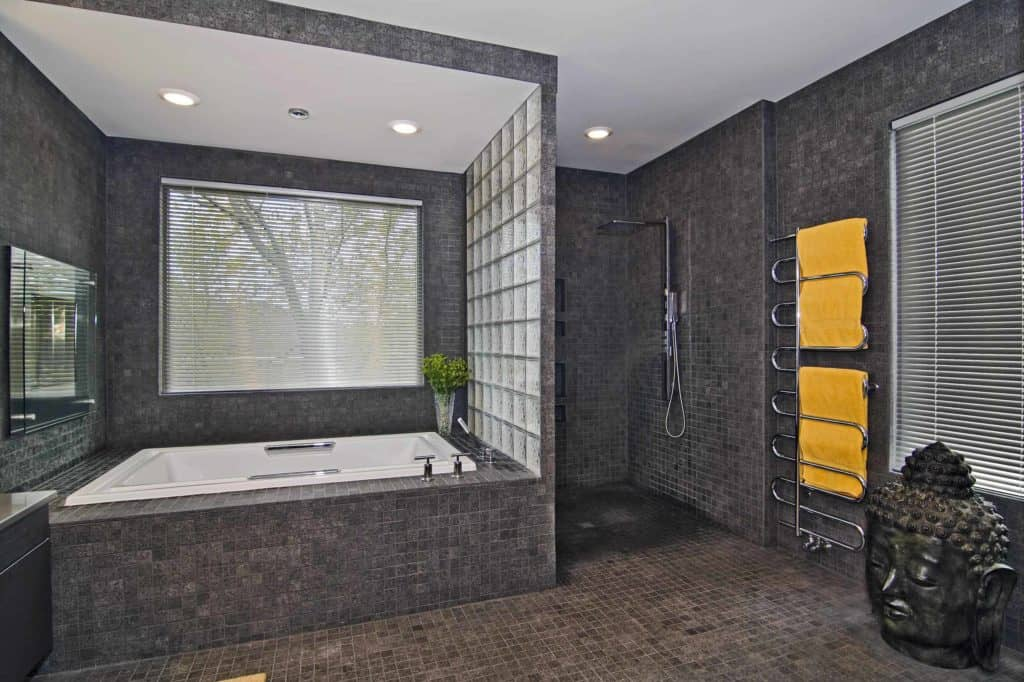 Omni-tile open shower with glass wall