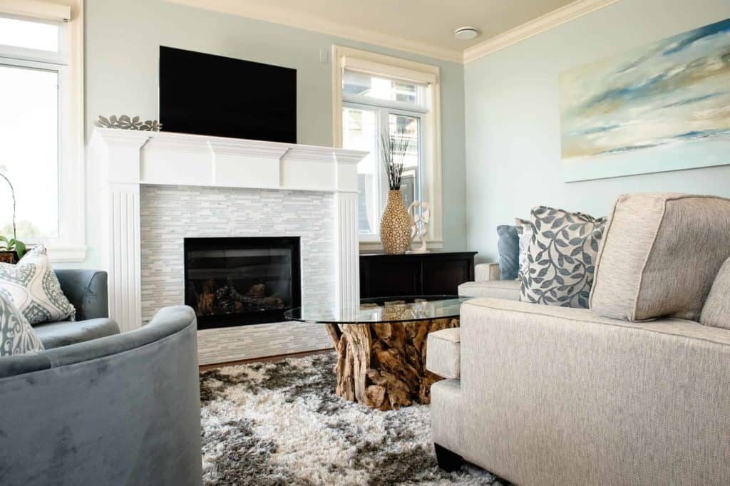 tiled fireplace ideas with driftwood coffee table