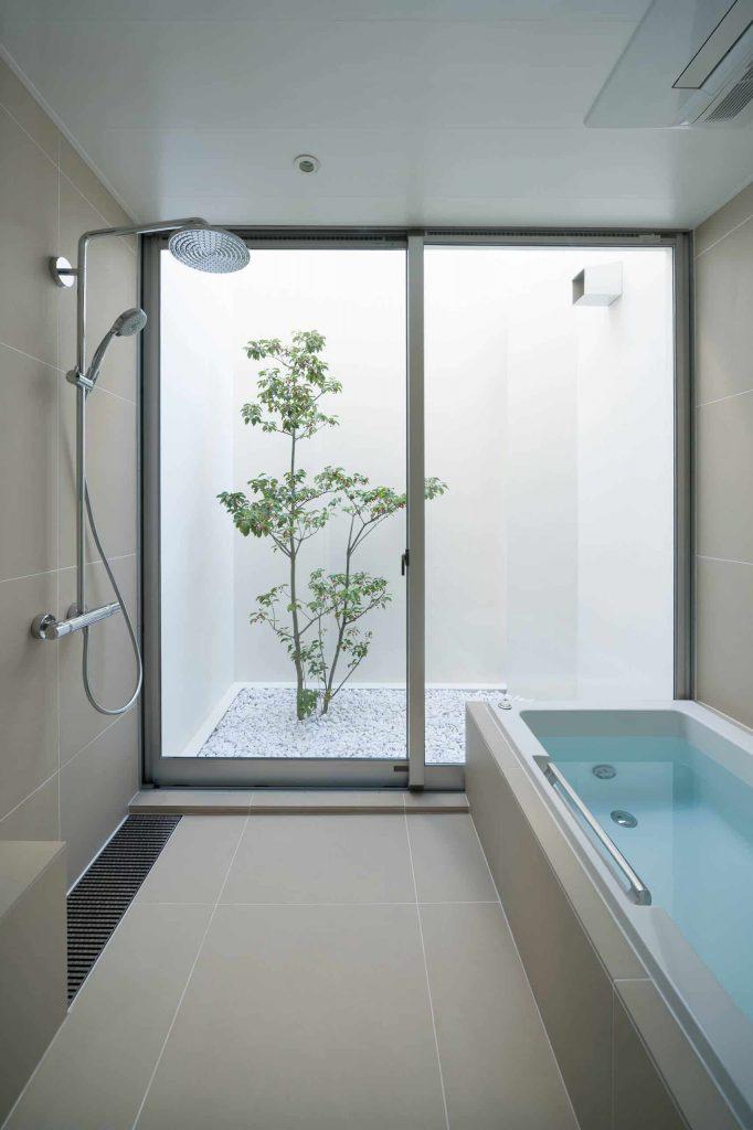 master beige tile beige floor bathroom idea in Tokyo