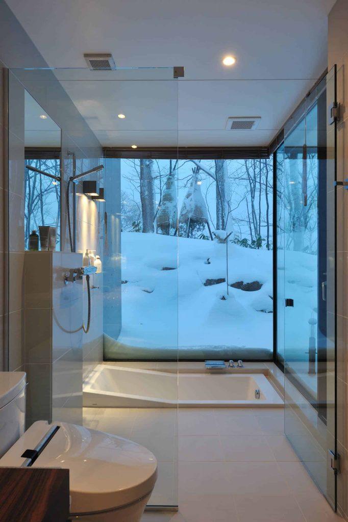 modern white tile bathroom idea in Sapporo