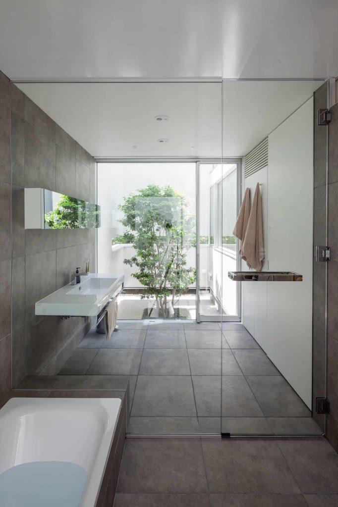 contemporary master gray tile bathroom idea in Yokohama