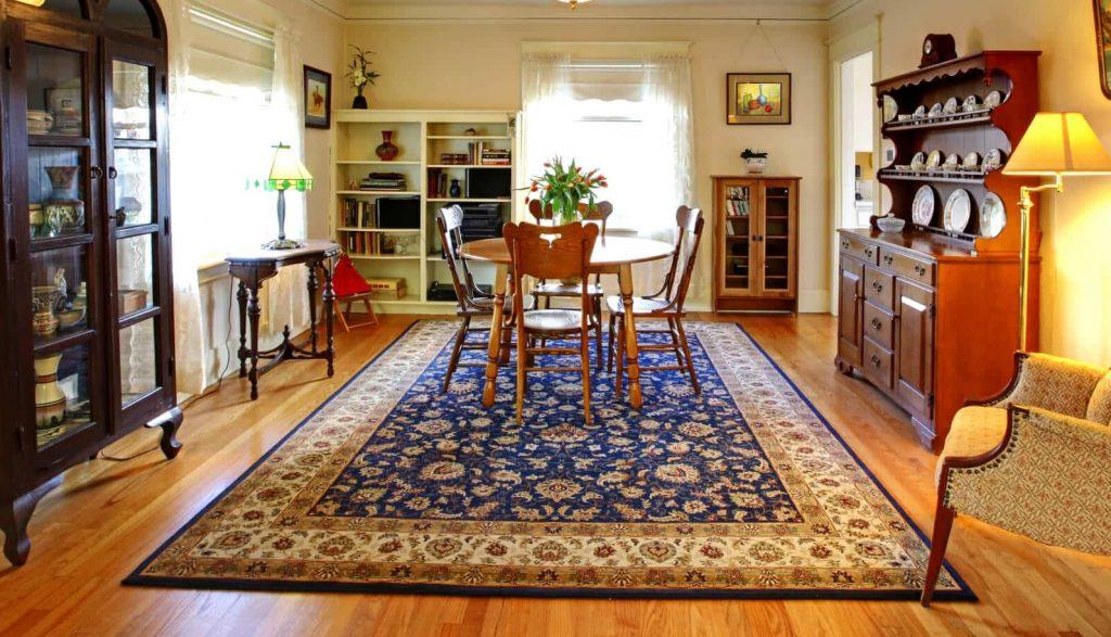 area rug on wood floor in living room