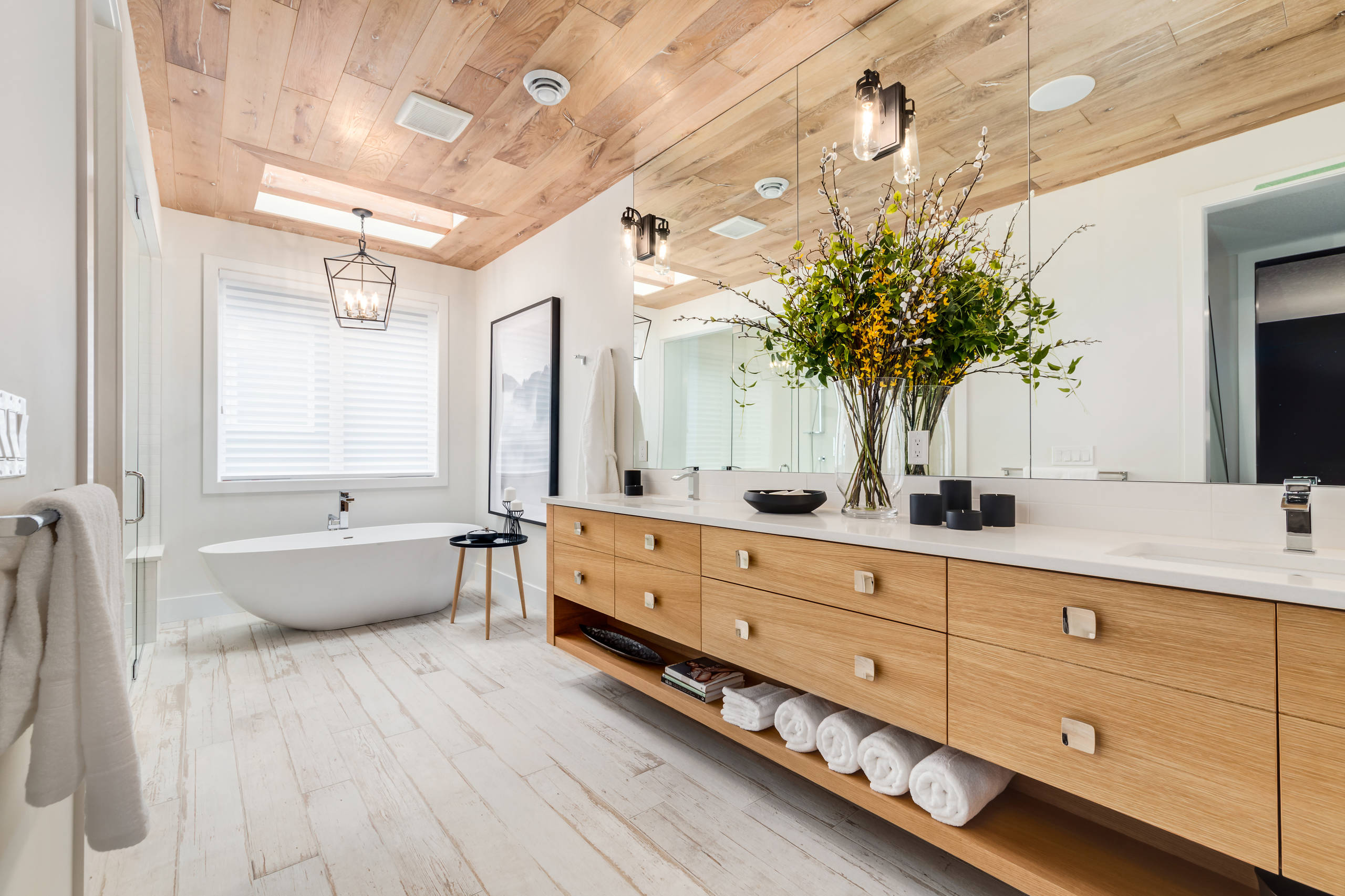 Bathroom - large contemporary master white floor and light wood floor bathroom idea in Calgary with flat-panel cabinets, light wood cabinets, white walls, quartz countertops, an undermount sink and a hinged shower door