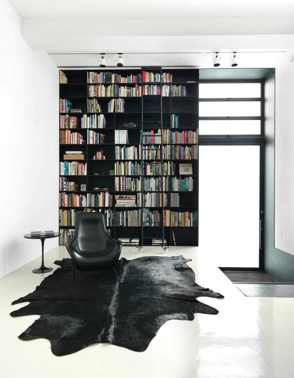 black faux cowhide rug