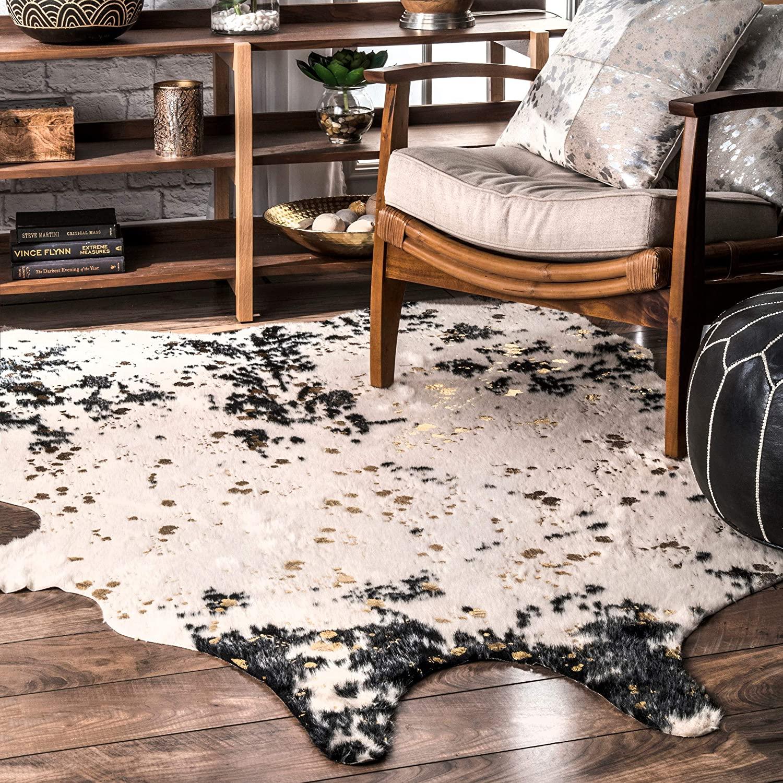 cowhide rug on hardwood floor